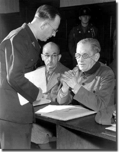 Mr. Lambertus Wartena, Chief of the Administrative Section of the Defense Information Center in Nuernberg, assists Field Marshal Maximillian von Weichs with his application for defense counsel. Von Weichs and eleven other high Wehrmacht officers were indicted on 10 May 1947 on charges of War Crimes and Crimes against Humanity committed during the German Occupation of the Southeast. Looking on, center, is Field Marshal Wilhelm List.
