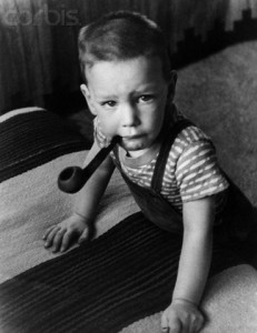 ca. 1940s --- J. Robert Oppenheimer's Son Peter with Pipe --- Image by © CORBIS