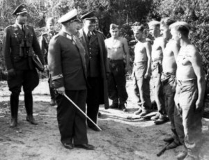 Hermann Goering and Albert Kesselring in the inspection of soldiers (shirtless)