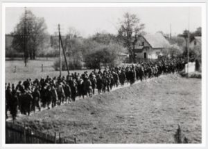 clandestine-photograph-of-prisoners-marching-to-dachau